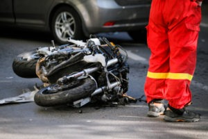 motorcycle on the road next to a first responder